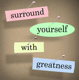 Surround Yourself With Greatness Saying Quote Words Motivation. Surround Yourself with Greatness words in a saying or quote pinned to a bulletin board for Royalty Free Stock Photography