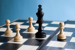 Surrounded. A king  by pawns Stock Photo
