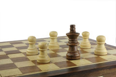 Surrounded black king. Black king surrounded by white pawns on the chessboard Stock Image
