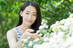 Surrounded by flowers girl Royalty Free Stock Photography