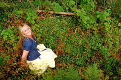 Surrounded By Nature. A beautiful blonde girl, in the woods, surrounded by nature royalty free stock photography