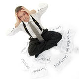 Surrounded by problems. Businessman in chalkstripe City suit and braces surrounded by problems Stock Images