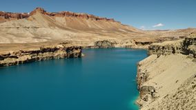 Natural dam in blue freshwater lake. Surrounded by travertine cliffs. Band-e Amir Lakes. Band-e Amir National Park, Bamyan Province, Afghanistan. Wide shot stock video footage