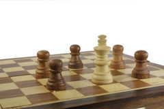 Surrounded white king. White king surrounded by black pawns on the chessboard Stock Photos