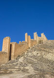 Surrounding city walls and tower of Albarracin Stock Photos