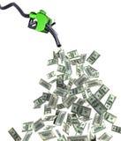 Surtidor de gasolina con los billetes de banco del dólar Foto de archivo