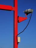 Surveillance. CCTV  camera on red steel frame Royalty Free Stock Image
