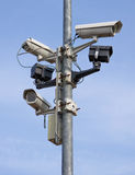 Surveillance. A post full of surveillance cameras stock images