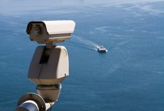 Surveillance camera. Is watching an approaching vessel stock photo