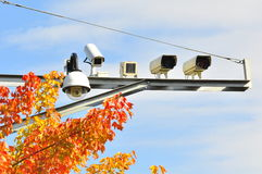 Surveillance Camera. Five surveillance camera hidden by trees by the road side for traffic speed surveillance. The function of each camera is different. The stock images