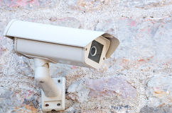 Surveillance camera. Security surveillance camera placed outdoor royalty free stock photo
