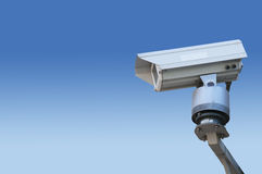 Surveillance camera. On blue degradation Royalty Free Stock Photo