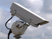 Surveillance Camera. With clouds in the background stock photography