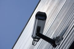 Surveillance Camera. Surveillance video camera attached on a wall of a building Stock Photo