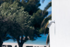 Surveillance camera above a beach Stock Photo