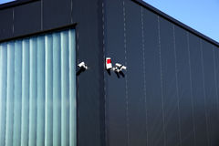 Surveillance camera and alarm system on a building Royalty Free Stock Images
