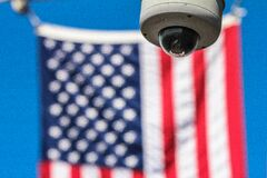 Surveillance camera and American flag royalty free stock photography