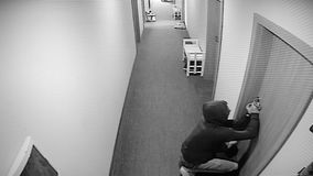 The surveillance camera captured as a thief breaks the apartment door stock video