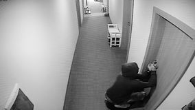 The surveillance camera captured as a thief breaks the door stock video footage