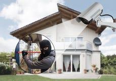 Surveillance Camera Capturing A Burglar Stock Photography