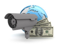 Surveillance camera and dollar bills Stock Photo