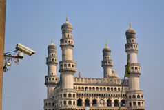 Surveillance camera in front of a mosque. A surveillance camera is looking at Muslim Chaminar in Hydarabad Stock Photos