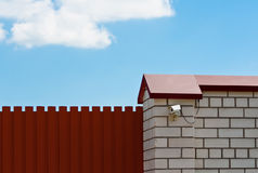 Surveillance camera on the gates Royalty Free Stock Image