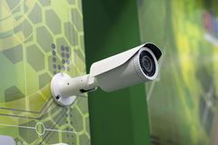 Surveillance camera is hanging on the wall. Electronics Stock Image