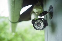 Surveillance camera on a house. Closeup of surveillance camera on a house royalty free stock images