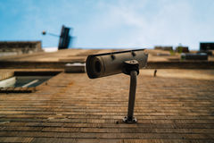 Surveillance Camera Installed in Brick Wall Royalty Free Stock Photography