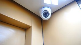 Surveillance camera installed in the Elevator stock footage