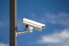 Surveillance camera on light pole Stock Photo