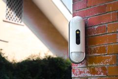 Surveillance Camera With Movement Detector on House Stock Photos