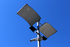 Surveillance camera. In outdoor, blue sky background royalty free stock images