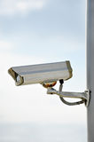 Surveillance camera on a pole Royalty Free Stock Image