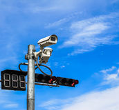 Surveillance camera and traffic light Royalty Free Stock Image