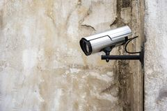 Surveillance camera on the wall background Stock Images