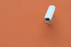 Surveillance camera on the wall, horizontal Royalty Free Stock Image