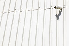 Surveillance camera on wall of industrial building Royalty Free Stock Photos