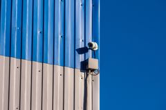 Surveillance camera on  wall royalty free stock image