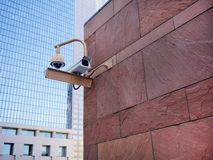 Surveillance Cameras. Two Surveillance cameras keeping watch in an urban environment Stock Images