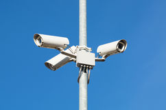 Surveillance cameras against blue sky Security Cctv Stock Image