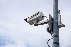 Surveillance cameras. Against sky background Royalty Free Stock Images