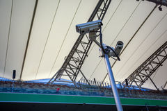 Surveillance cameras controlling playing field and tribunes Royalty Free Stock Photo