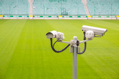 Surveillance cameras controlling sport pitch Royalty Free Stock Image