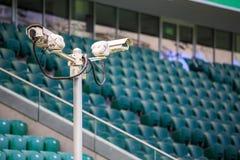 Surveillance cameras controlling stadium Royalty Free Stock Image