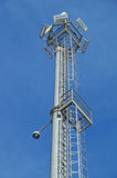 Surveillance cameras and modern lighting fixtures on the lamppost.  Royalty Free Stock Photography