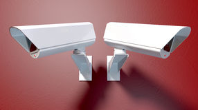 Surveillance Cameras On Red Royalty Free Stock Images