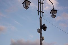 Surveillance cameras on a street lamp stock images