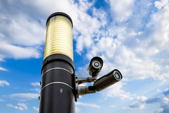 Surveillance cameras on the streets of the city skyline Stock Image